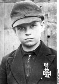 A 12-year old Hitler Youth leader receives the Iron Cross, Second Class for combat performance, March 1945.