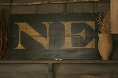 Reproduction 18th c New England 'NE' Colonial Wooden Sign. $70.00, via Etsy.