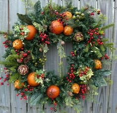 Christmas Fruit Wreath In this beautiful Christmas wreath, realistic fruit with cloves, pine and berries create a beautiful, classic look. People will be constantly touching this wreath wondering if the fruit is real! Average diameter: (tip to tip) Christmas Door Wreaths, Christmas Flowers, Natural Christmas, Holiday Wreaths, Beautiful Christmas, Christmas Holidays, Holiday Decor, Christmas 2019, Wreaths Crafts