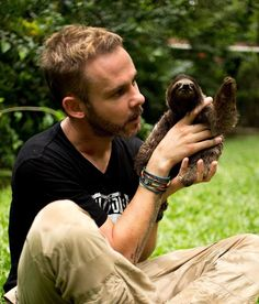 His face is the proper face for meeting a baby Sloth.  Dominic Monaghan & cute tiny friend! (Or baby sloth & cute friend!)
