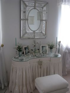 Love the vanity shape, the fluffy skirt, and glass top and mirror