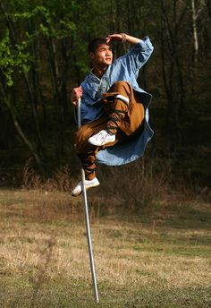 Shaolin monk demonstrating a technique learned from the Monkey King, legendary master of the staff.