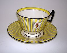 Doulton deco: unnamed tea duo by Robert Allen, E9652, RA8212C, c1915 (pattern). Yellow colourway - yellow and black stripes with fruit and vase cameo and black highlights and trim.