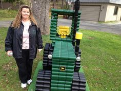 """Nothing says """"chic"""" like backyard beer can art.  We call this one """"Nothing Runs Like A Beere"""".  We are huge fans of this John Deere aluminum can tractor art."""