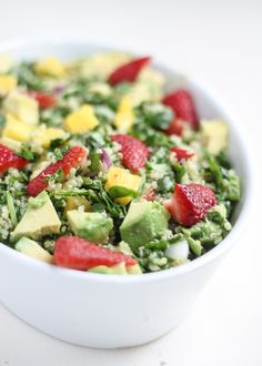 Nutritious and flavorful spinach quinoa salad bursting with mango, strawberries, avocado and a scrumptious sesame-lime vinaigrette. Great for parties! Gluten free, vegan-friendly and wholesome.