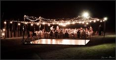 Outside wedding with dance floor and tables outside