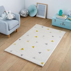 Grafico Triangle Print Child's Rug LA REDOUTE INTERIEURS The Grafico Triangle Print Child's Rug. This colourful rug has a charming geometric triangle pattern.