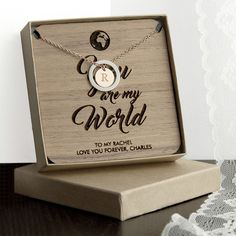 Personalise the necklace with one initial on each side of the charm and choose from two colourways The wooden keepsake is made from Walnut Wood and