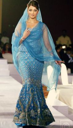 Aishwarya Rai is so beautiful.  Love this sari/dress!!