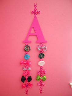 Custom-Made Letter Bow Holder/Organizer. Purchase at sassychalets.etsy... good idea for catie!