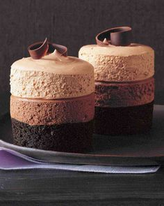 Triple-Chocolate Mousse Cake Recipe -- The dark-chocolate cake at the base is baked in ramekins. Two layers of plush, pillowy mousse -- bittersweet and milk chocolates -- are piped on top and capped with semisweet chocolate curls. Triple Chocolate Mousse Cake, Chocolate Desserts, Chocolate Curls, Dark Chocolate Cakes, Food Cakes, Cupcake Cakes, Mini Cakes, Cupcakes, Cake Recipe Martha Stewart