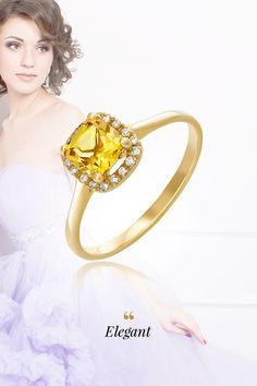 """Vedeli ste, že zlatý beryl sa nazýva aj """"heliodor""""? Tento názov je odvodený z gréckeho slova """"helios"""", čo v preklade znamená slnko. A práve slnko zosobňuje hojnosť a životnú silu. No keďže nám nesvieti celý rok v rovnakej intenzite, je vhodné urobiť si slnečné """"zásoby"""", a to prostredníctvom nášho dokonalého prsteňa Elegant s centrálnym zlatým berylom a 18 briliantmi. Práve táto nesmrteľná kombinácia z neho robí čoraz častejšiu voľbu pri kúpe zásnubného prsteňa."""