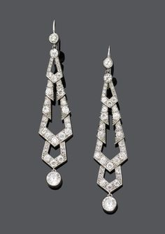 These beautiful diamond earrings sold for about $7000 at auction. They are lovely.