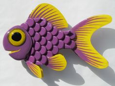 Hey, I found this really awesome Etsy listing at https://www.etsy.com/listing/150999789/goldfish-upcyled-art-bottle-cap-wall-art