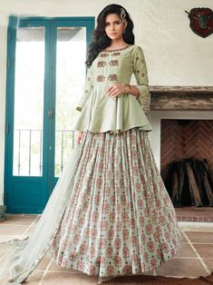 Fantastic green embroidered gown online at best shopping price. Shop this latest gown style for diwali celebration. This alluring style set comprises a silk gown with matching net dupatta and silk bottom.