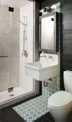 this reminds me of the way we are going with this bath.  it has a shower, with tile that's not my favorite, kind of like the one shown here, but with the patterned tile elsewhere and industrial lighting