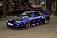 Skyline R34. Ugly in a beautiful way. Japanese engineering at its best.