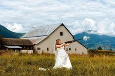 Bride shooting shotgun on wedding