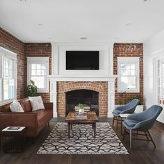 Rafterhouse Bungalow Seating area with exposed brick walls and fireplace Exposed Brick Fireplaces, Brick Fireplace Wall, Fireplace Seating, Family Room Fireplace, Exposed Brick Walls, Home Fireplace, Bungalow, And So It Begins, Family Room Design