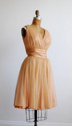 Vintage 1950's dress. I used to have the body for these beautiful dresses....
