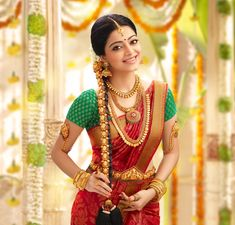 Beautiful South Indian Bride in Red and Green Silk Saree and Gold Jewelry