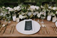 Chic Nature-Inspired Wedding at Calistoga Ranch, Place Setting with Black Menu | Brides.com