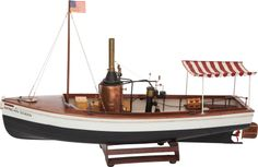 LIVE STEAM MODEL OF THE RIVER BOAT 'AFRICAN QUEEN'  Length 29 inches (73.7 cm)  Rare, expertly built 1.12 scale model of the battered river boat made famous in the 1951 movie starring Humphrey Bogart, with authentic details including distressed vertical copper boiler. Has vertical copper boiler engine