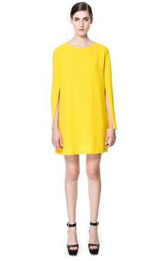 DRESS WITH CAPE SLEEVE from Zara. Pear ladies, this will look AWESOME on you! I would suggest pairing it with neon pink or emerald green accessories.