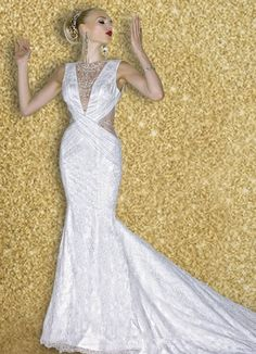 A sultry sheath made of sustainable lace, lined in the most luxurious   silk charmuese. This knockout gown is adorned with a dazzling Swarovski crystal neckpiece and waist inserts.