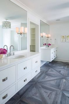 The wood-like flooring selected for this bathroom is a 30″ x 30″ tile from AKDO. Interior Design Ideas