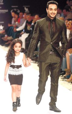 TV actor Angad Hasija with daughter at the India International Jewellery Week 2013. #Bollywood #Fashion