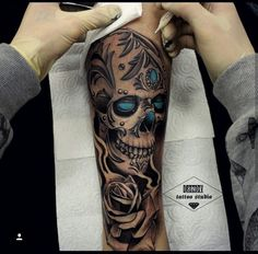 This skull tattoo is really elegant. All these gems and blue light inside this skull talk about its royal roots. The style this Elegant Gems Inlaid Skull tattoo Skull Rose Tattoos, Skull Sleeve Tattoos, Body Art Tattoos, Trendy Tattoos, Tattoos For Women, Tattoos For Guys, Cool Tattoos, Skull Tattoo Design, Tattoo Designs