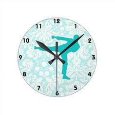 """Teal Martial Arts Round Clock:  You will love this cute teal damask martial arts karate kickboxing taekwondo kick """"Tae Kwan Do"""" design. Great for gifts! Available on tee shirts, smart phone cases, mousepads, keychains, posters, cards, electronic covers, computer laptop / notebook sleeves, caps, mugs, and more! Visit our site for a custom gift case for Samsung Galaxy S3, iphone 5, HTC vivid / Raider 4 G, Kindle Fire, Droid RAZR, or iPad & iPad mini!  #teal #martialarts #wallclock"""