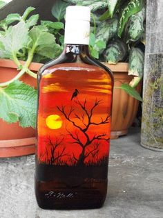 Painted bottle in acrylic, red sunset theme