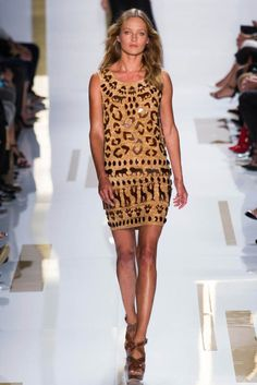 We have an animalistic lust for this awesome DVF 2014 dress