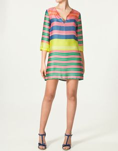 Zara: Large Striped Blouse $59.90 -- This dress just makes me smile. Pair it with the Kendra Scott cocktail ring, GORGEOUS!