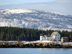 Winter Harbor Light, Mark Island, view from West side of Schoodic Point with Cadillac Mountain in the background