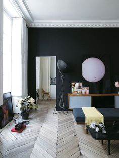 Jean Christophe Aumas' Paris apartment occupies a 300 year old ex-convent with original parquetry intact.