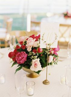 Blush, magenta and red wedding centerpieces: http://www.stylemepretty.com/tennessee-weddings/franklin/2016/08/16/spring-wedding-at-carnton-plantation-in-franklin-tn/ Photography: Nathan Westerfield - http://www.nathanwesterfield.com/