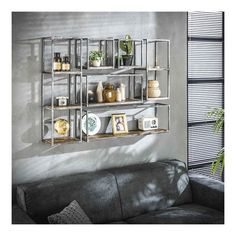The hardwood wall shelf Polly is made of robust hardwood with a sanded metal frame. This combination gives this contemporary wall shelf a vintage look. Cubes, Affordable Furniture, Beautiful Wall, Leicester, Wall Shelves, Bathroom Medicine Cabinet, Storage Spaces, Liquor Cabinet, My Design