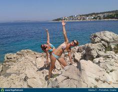 #Yoga Poses Around the World: Triangle Pose taken in Primošten, Croatia by Slávka F.