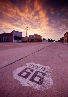 Route 66 Day 2: A Route 66 marker on the road in Erick, Oklahoma. Pinned by #CarltonInnMidway - www.carltoninnmidway.com