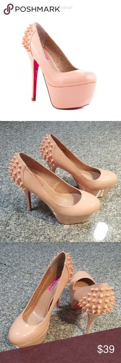 Betsey Johnson spiked ginger nude heel - size 9 Please see photos for details!! They have been in my closet for awhile and I've never worn them. They have been tossed around and have a couple scuffs and has a spot where it tore a little. Not in the best of shape but only if you look close!!   Add zing to any ensemble with the Ginger by Betsey Johnson. A lustrous nude patent blankets over the entire pump while showing off a 2 inch platform and 5 1/2 inch heel. Blended spikes stick out from…