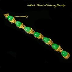 Panetta signed faux Emerald and Nugget style Gold Tone Link Bracelet