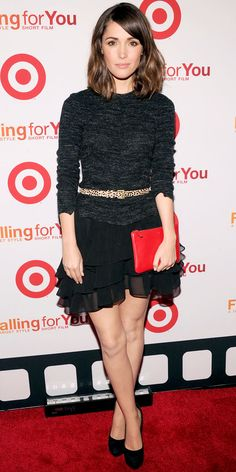 At the Target short film debut of Falling for You, Rose Byrne styled her belted sweater with a red clutch, tiered miniskirt and black pumps.
