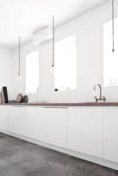 white kitchen -  minimalist pendants