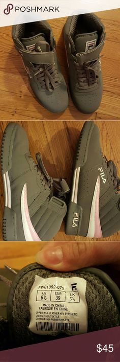 Gray high top Fila shoe Barely worn Gray, white and pink suede Hightop shoes Fila Shoes Sneakers