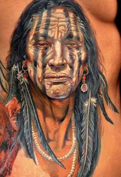 Loving the accessories on this outstanding portrait. Tattoo by Dmitriy Samohin. #inked #Inkedmag #tattoo #indian #american #portrait #idea