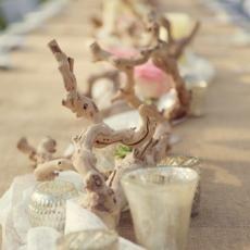 Centerpieces  wood branches candle votives