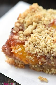 Peach Crisp Bars ~ a buttery shortbread crust is topped with sweet, ripe peaches and an oat-flecked crumble in this delicious, easy-to-assemble summertime dessert recipe! | FiveHeartHome.com